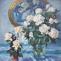 White Roses in a Vase on a Blue Table Cloth